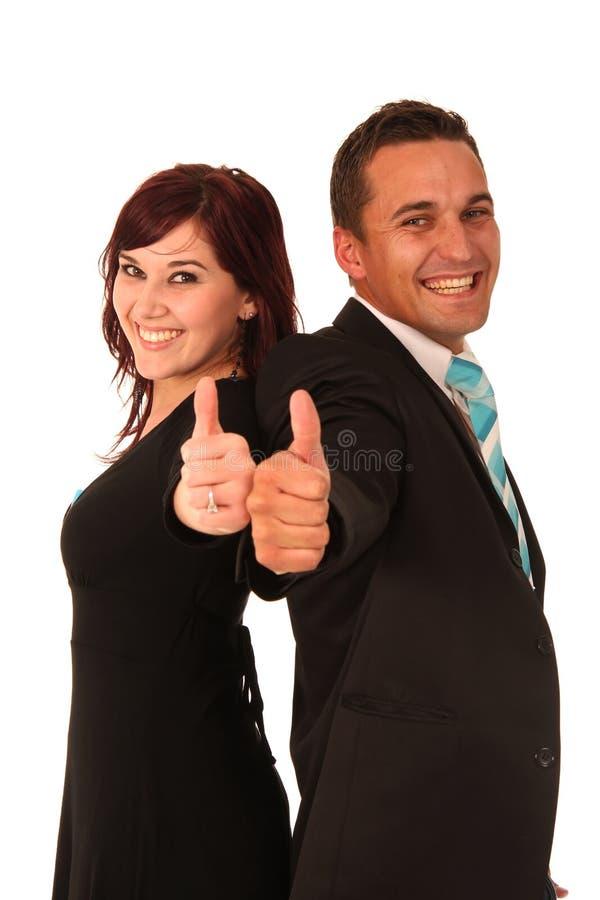 mannen tumm upp kvinna arkivfoto