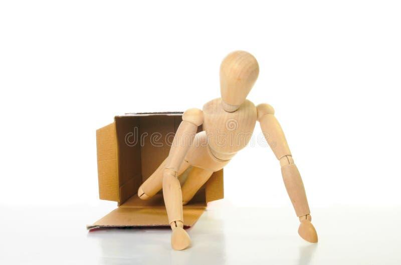 Mannequin aus Kasten heraus lizenzfreies stockbild