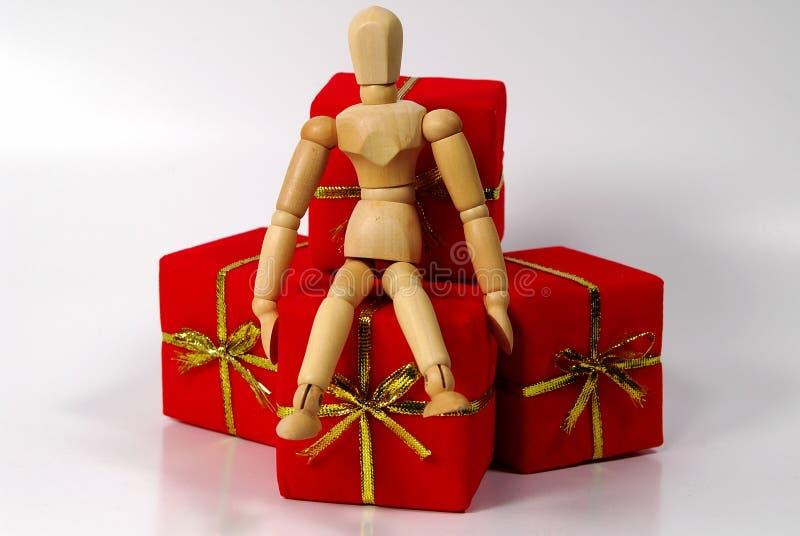 Mannequin avec des cadeaux photo stock