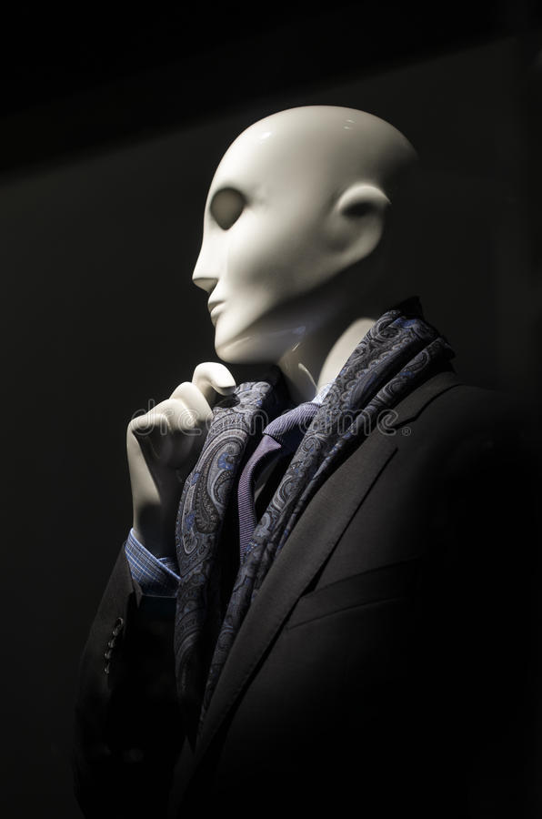 Mannequin in black suit & purple tie stock photo
