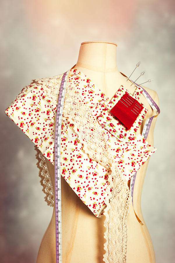 Mannequin With Colour Swatches. Dressmakers mannequin with colour swatches stock photo