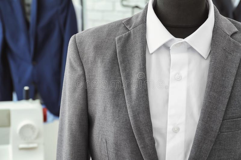 Mannequin with custom tailored suit and shirt in atelier, closeup stock photography