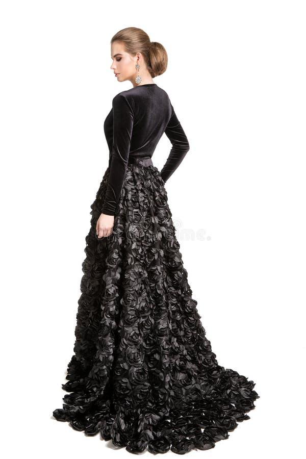 Mannequin dans la robe noire, longue robe de soirée de femme élégante, portrait arrière de beauté de vue arrière de fille, blanc image libre de droits