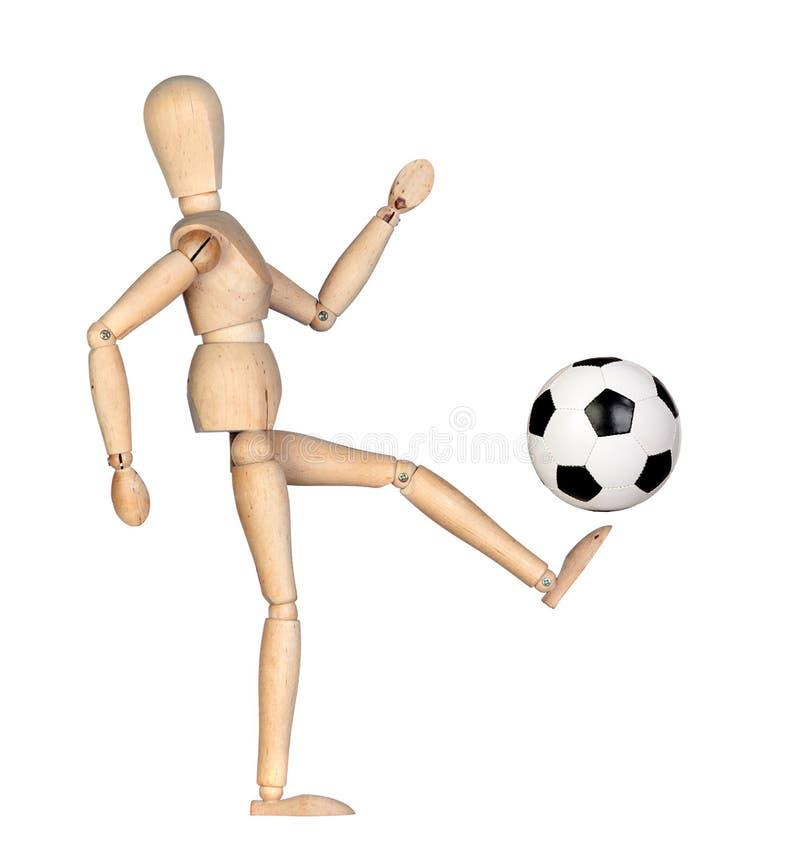 Mannequin de madeira com uma esfera de futebol imagens de stock royalty free