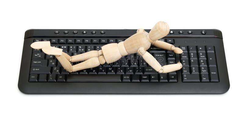 Mannequin di legno su una tastiera immagine stock libera da diritti