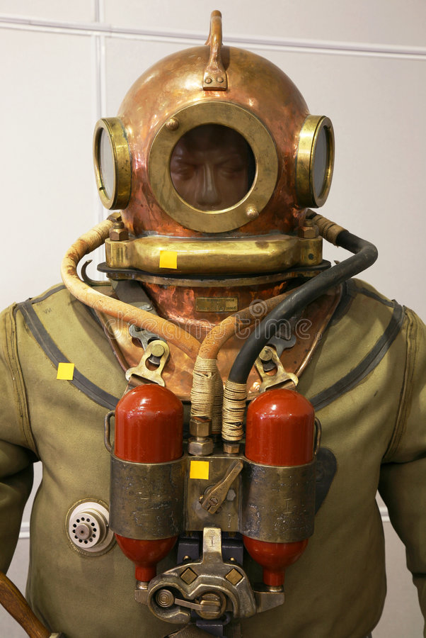The mannequin is dressed in a. Diving suit with a round copper helmet and oxygen cylinders stock photos