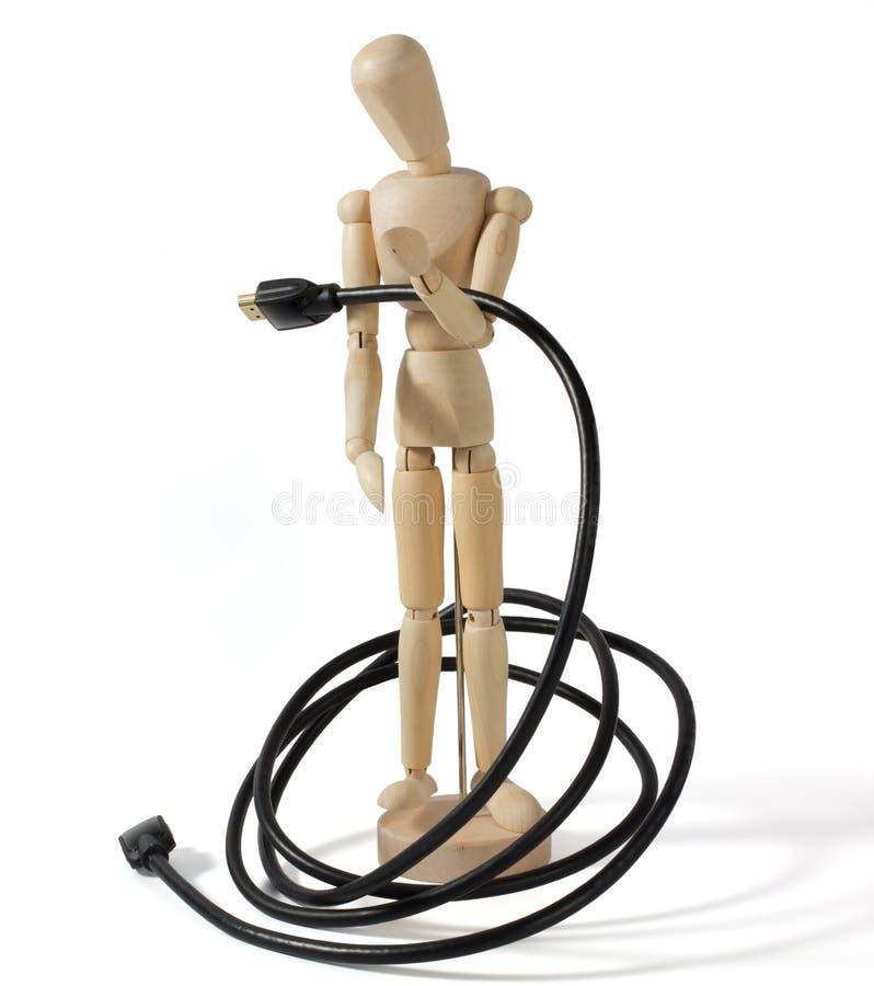 Mannequin en bois avec un câble de multimédia photographie stock libre de droits