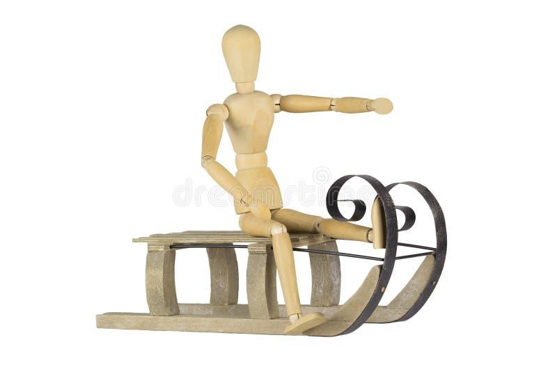 Mannequin en bois sur un traîneau image stock
