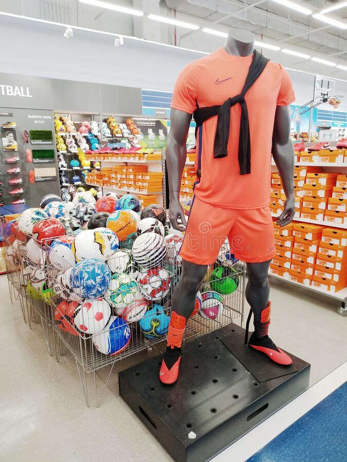 Mannequin of a football player and a lot of football balls at a sports store royalty free stock photography