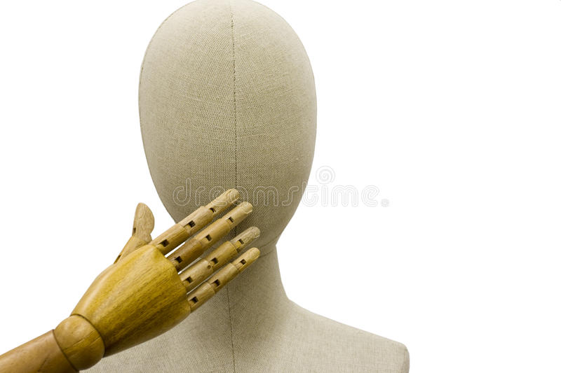Mannequin with Hand over Mouth. A linen covered mannequin head with wood hand over mouth isolated on white background stock photo