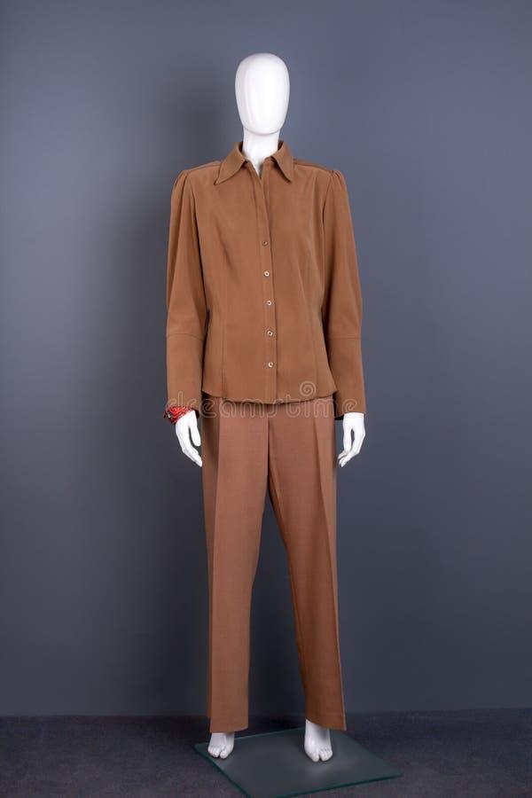 Free Mannequin In Women Brown Suit. Stock Image - 109701151