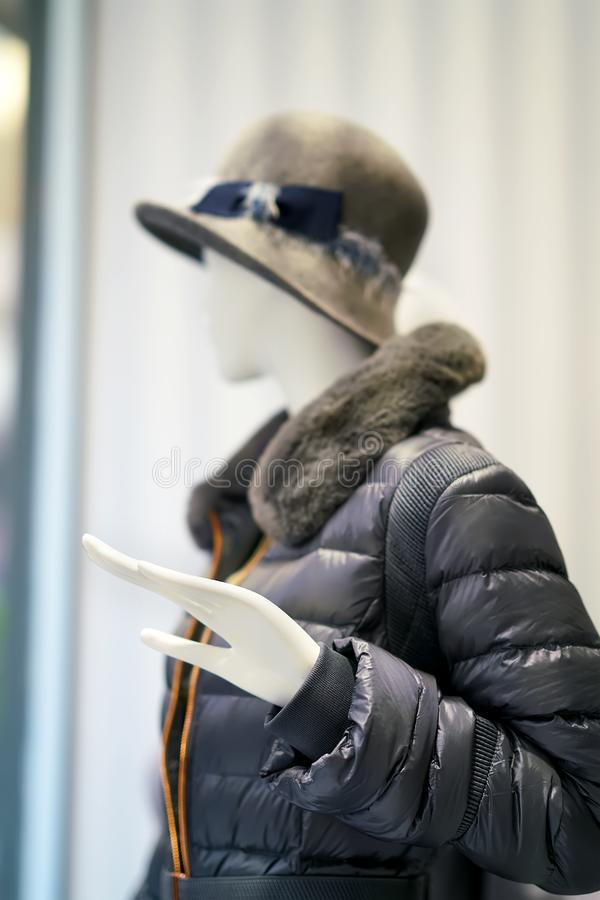 Mannequin with jacket and hat stock photography