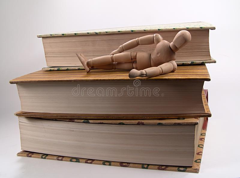 Mannequin Laying on Books