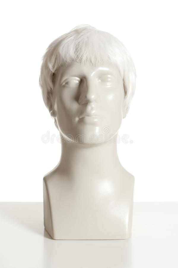 Mannequin Male Head with Wig on White. Mannequin Male Head with Wig royalty free stock images