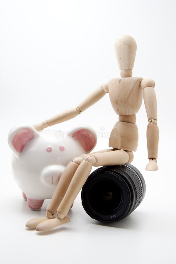 Mannequin mit Objektiv und piggy Querneigung stockbilder