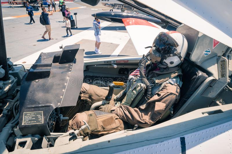 Mannequin pilot in cockpit of plane on the Uss Midway aircraft carrier museum at the San Diego Harbor California clear summer day. The USS midway is a retired royalty free stock photo