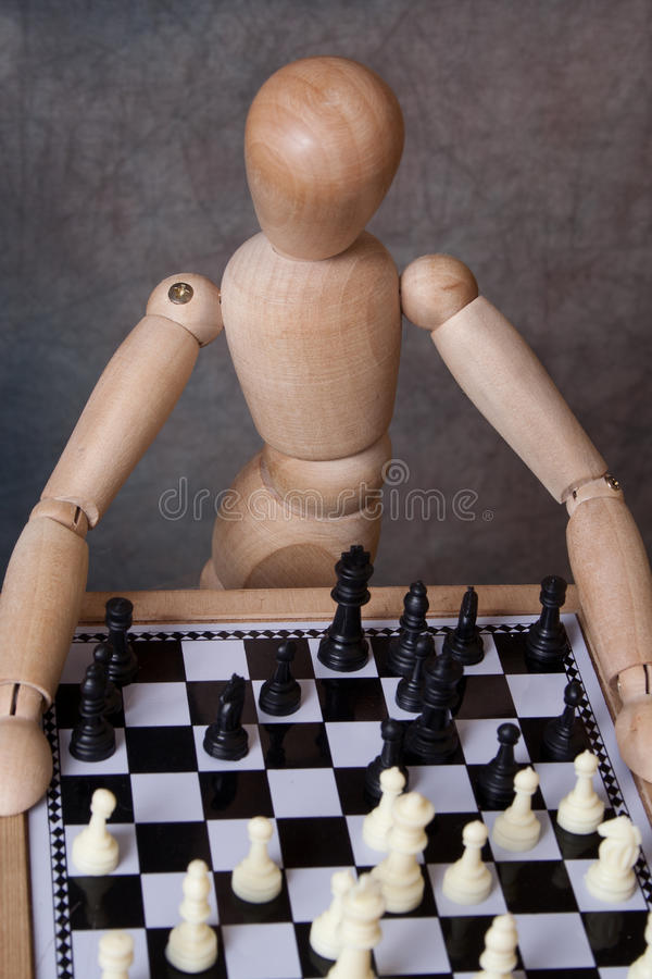 Mannequin playing chess stock photography