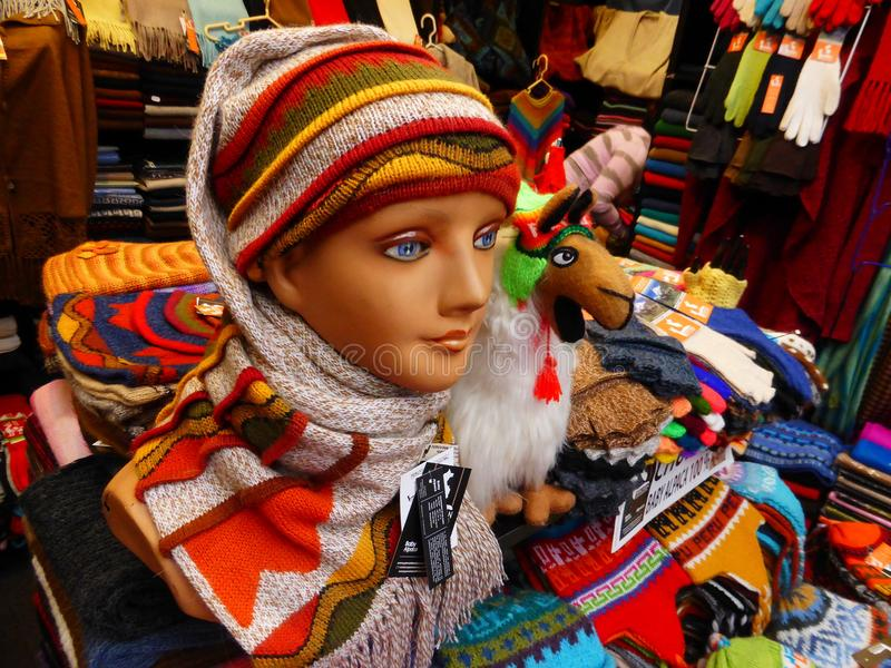 Alpaca wool products for sale in shop. Mannequin and products made from alpaca wool for sale in a shop in Lima, Peru stock photos
