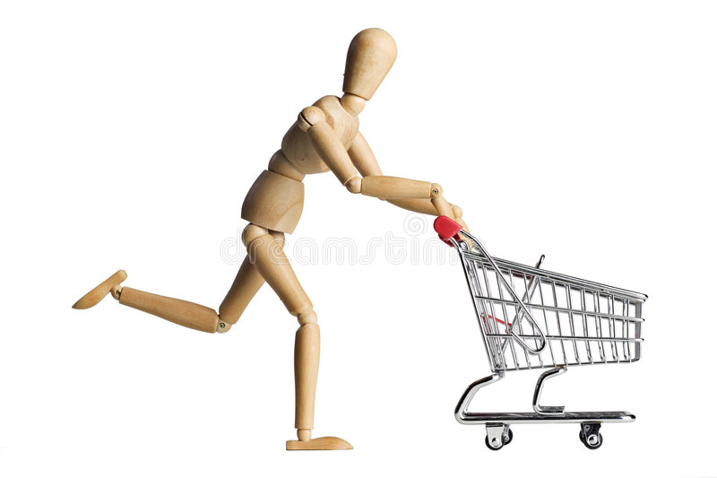 Mannequin pushing a shopping cart. Mannequin posed as if it is pushing a shopping cart stock photography