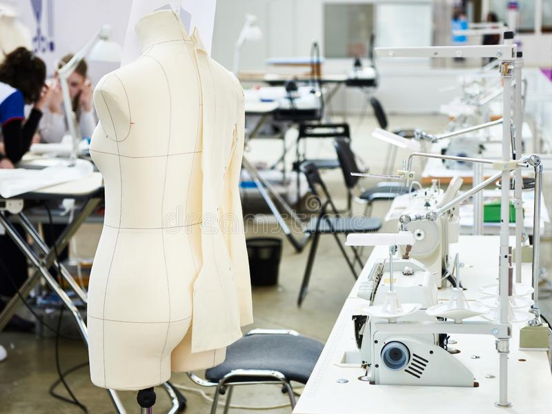 Mannequin in sewing workshop. Mannequin silhouette in sewing workshop royalty free stock photos