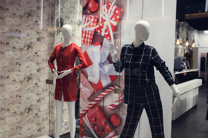 Mannequin stand in the window of a fashion store royalty free stock image