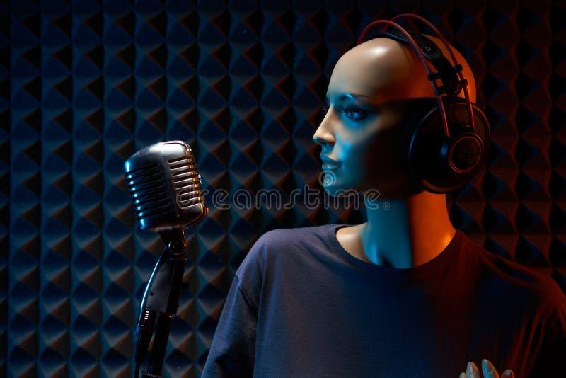 Mannequin with studio retro condenser microphone and professional headphones stock images
