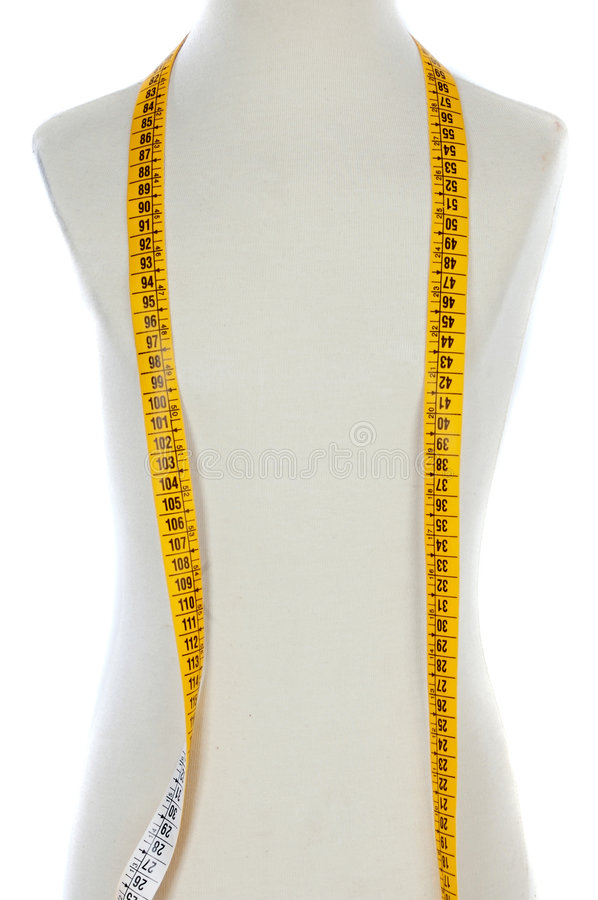 Mannequin with a tape measure royalty free stock photo