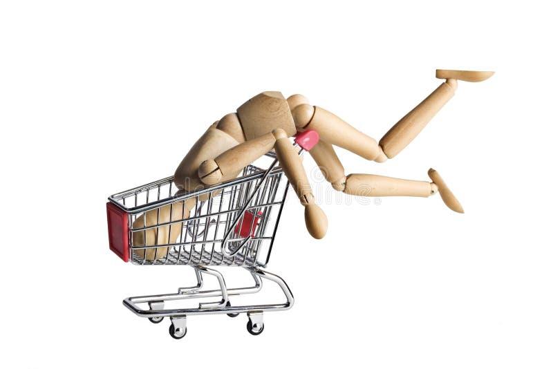 Mannequin in un carrello di acquisto fotografia stock libera da diritti