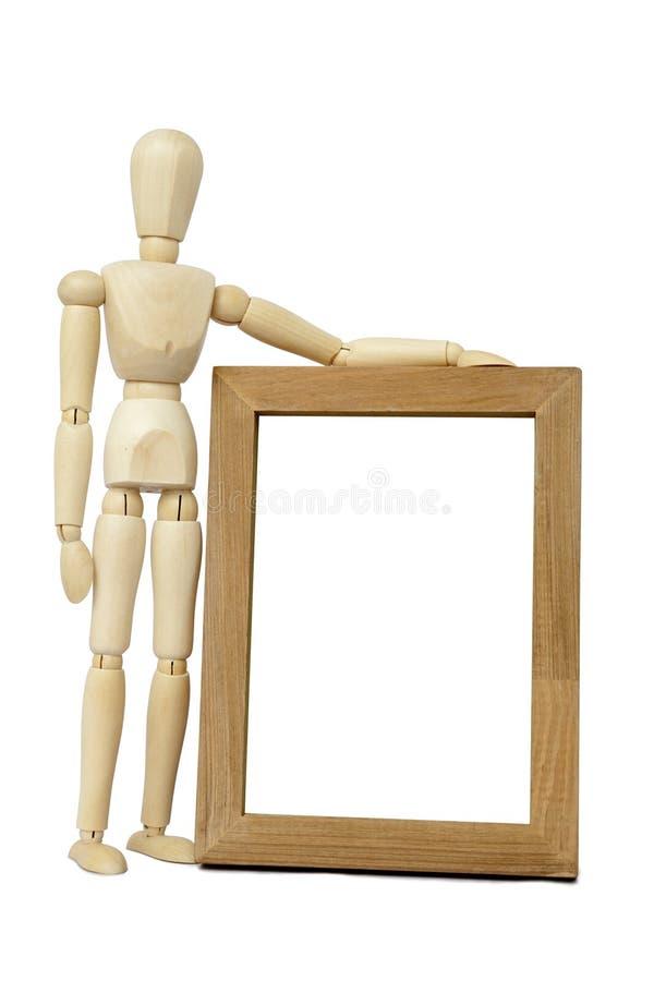 Mannequin und Holzrahmen stockfotografie