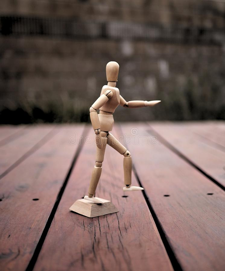 Articulating Artist Wood Mannequin on Wooden Deck stock images