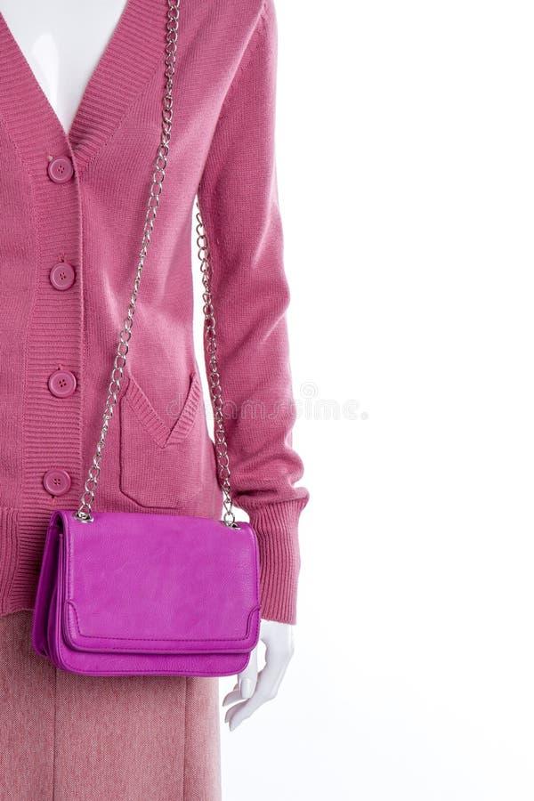 Mannequin z różowym skóry sprzęgłem zdjęcia stock