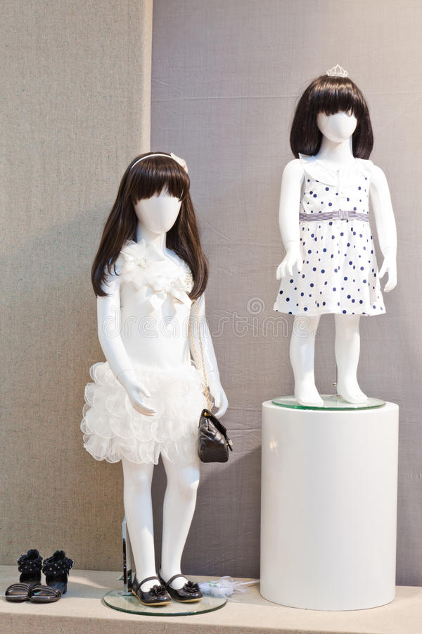 Mannequins in children's clothing store stock image