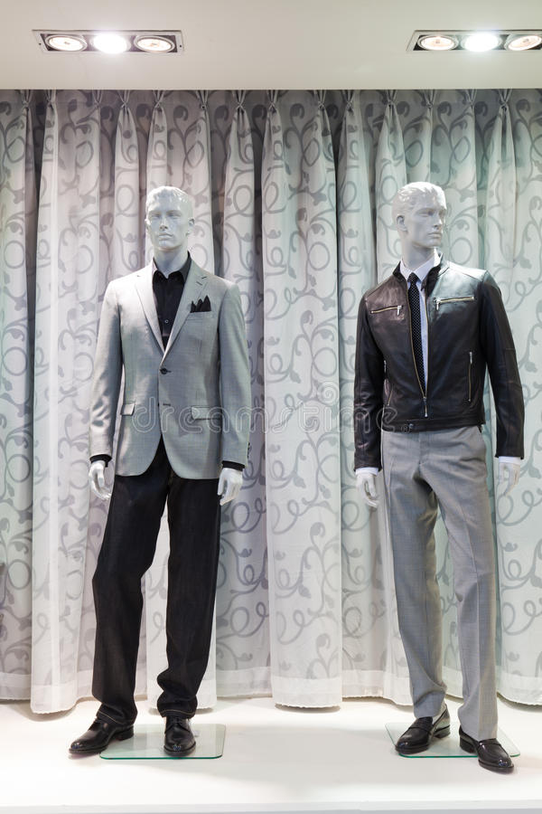 Mannequins in a men fashion store stock image