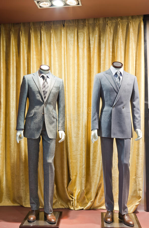Mannequins in a men fashion store royalty free stock image