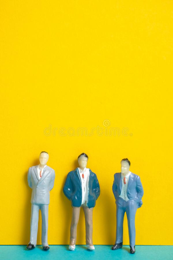 Mannequins of men stand on a yellow background. royalty free stock images