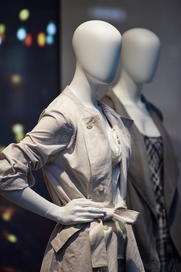 Mannequins standing in store window display of womens casual clothing shop royalty free stock photography