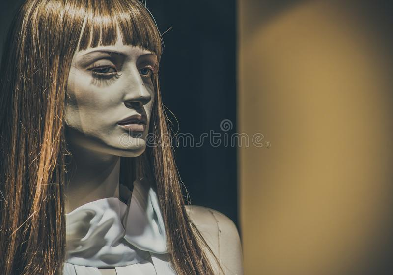 Mannequins in stores. Dolls royalty free stock image
