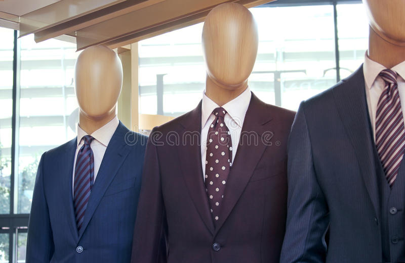 Mannequins with suit. Mannequins with men's suit in a retail showroom royalty free stock photos