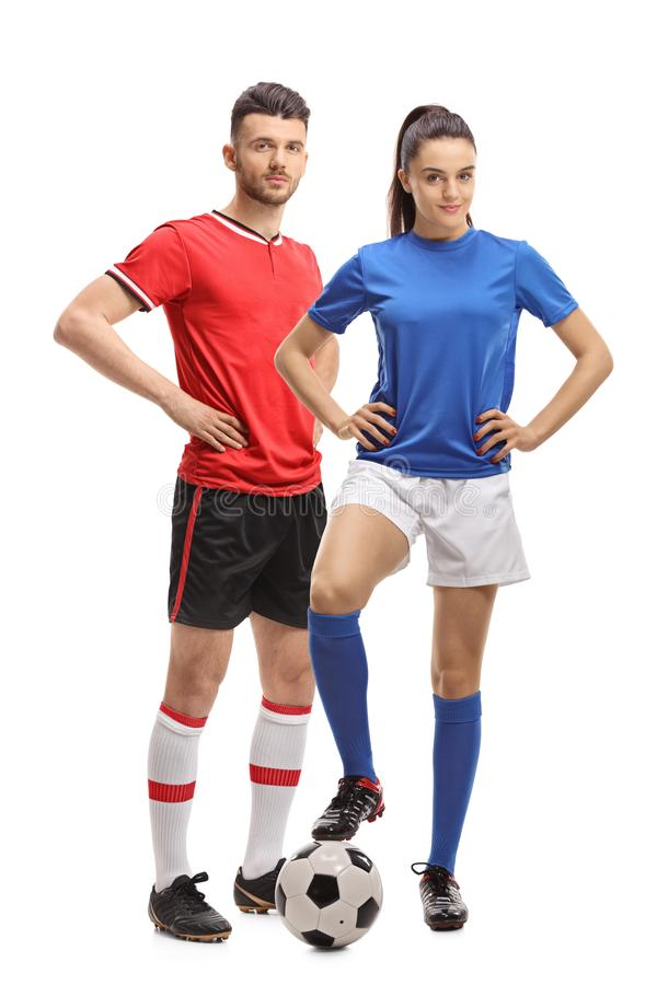 Mannetje en een vrouwelijke voetballer met een voetbal royalty-vrije stock foto