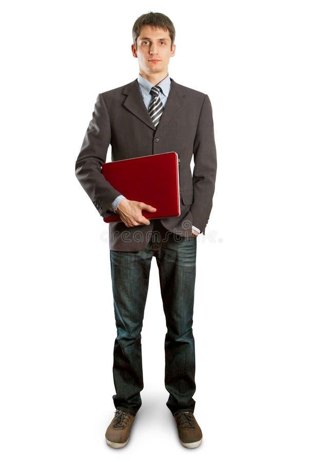 Mannetje in kostuum met laptop in zijn handen royalty-vrije stock afbeelding