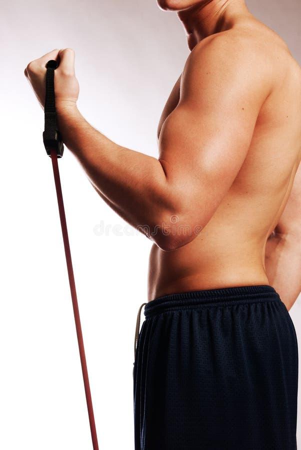 Mannetje met de kant van trainingriemen stock fotografie