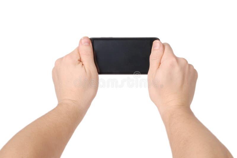 Mannhand, die den Smartphone hält stockbilder