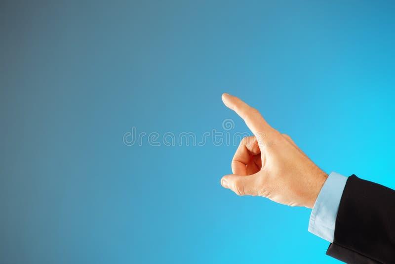 Mannhandzeigen lizenzfreies stockfoto