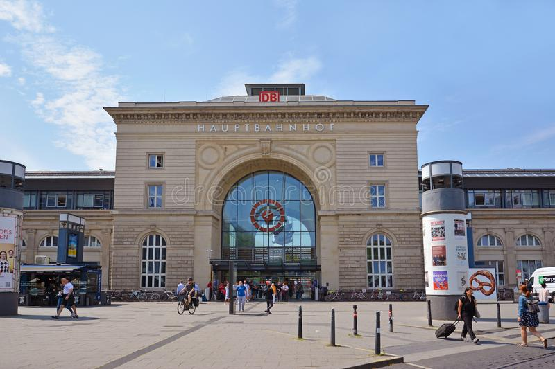 Front view of facade of Mannheim central railway station in old historical building with travelers passing by on summer day stock photos