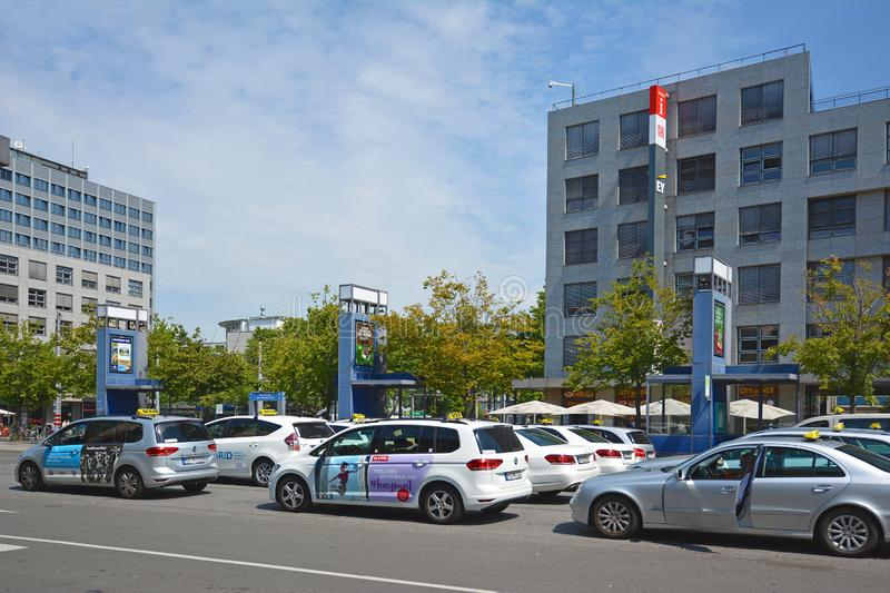Many taxi cars parking and waiting for passangers in front of Mannheim main station stock photos