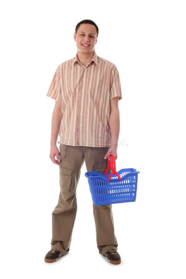 Mannholding-Einkaufskorb lizenzfreie stockfotografie