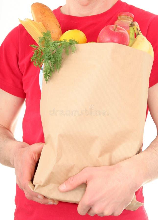 Mannholding-Einkaufstasche lizenzfreie stockfotos