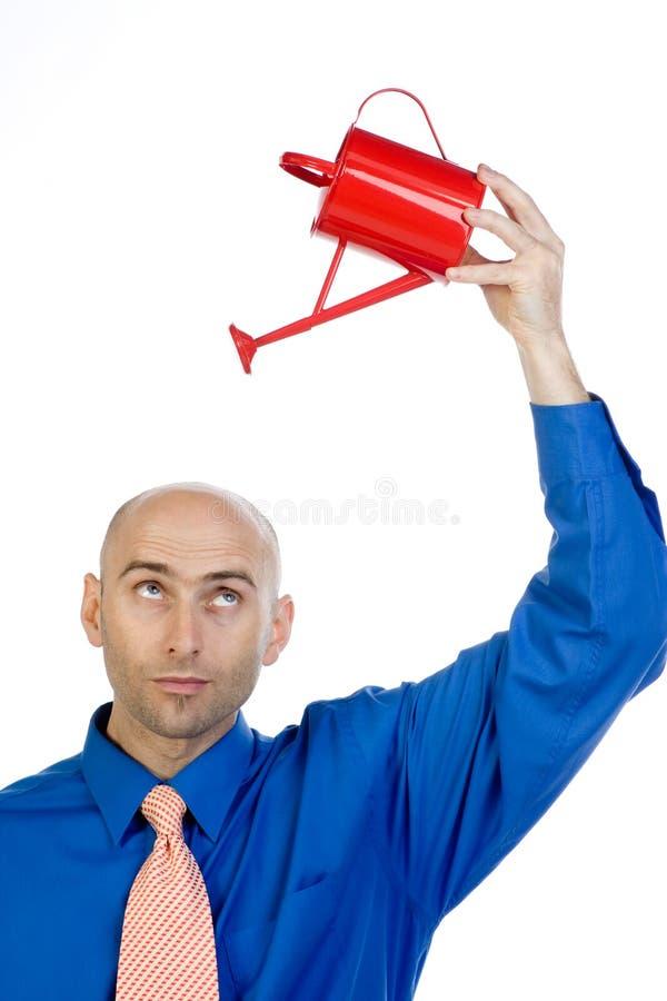 Mannholding kann obenliegend stockfotografie