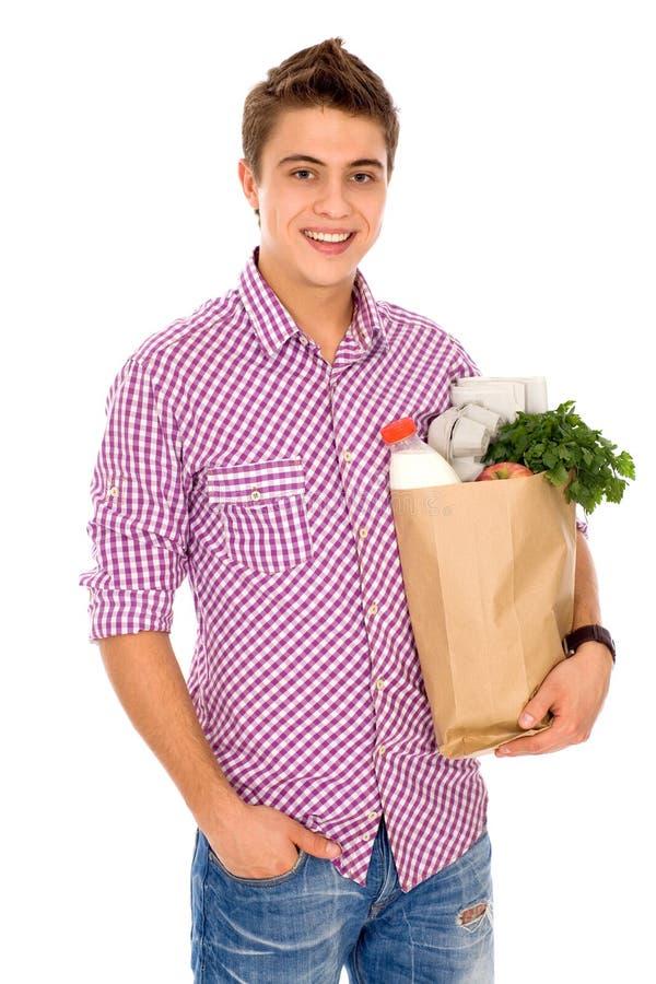 Mannholding-Lebensmittelgeschäftbeutel stockbild