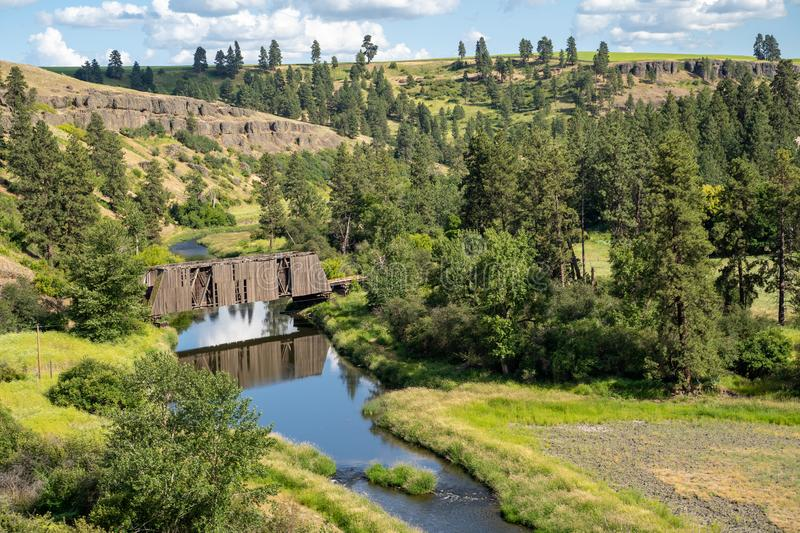 Manning-Rye Covered Bridge in the Palouse region of Washington State, spans the Palouse river in Colfax, WA stock images